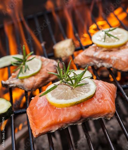 Fototapeta Grilled salmon steaks on fire