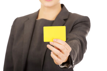 Businesswoman holding blank card.