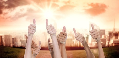 Composite image of thumbs raised and hands up