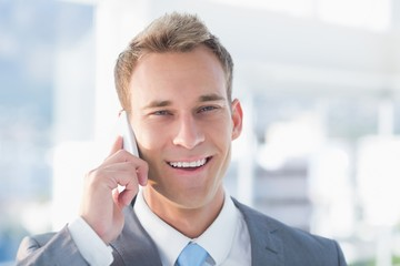 Smiling businessman calling on the phone