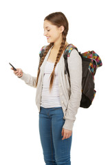 Teen with backpack sending sms.