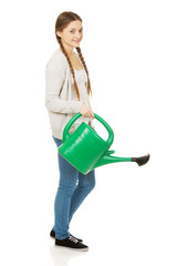 Teen woman with watering can.