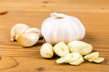 Peeled and sliced garlic cloves with garlic bulb and cloves