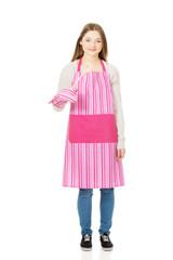 Happy teen woman wearing kitchen apron.