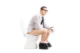 Young man sitting on a toilet