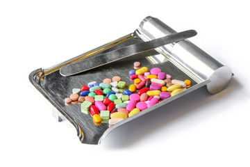 Pills on a counting tray on white background