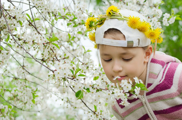 the young girl with a wreath from yellow flowers on the head