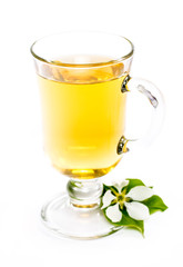 isolated glass of apple drink and flower