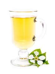 isolated glass of apple juice and flower