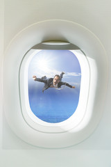 business man floating mid air out side passenger plane window