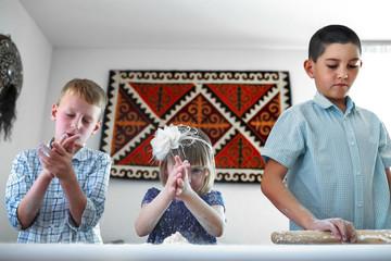 Cooking fun - children preparing dough