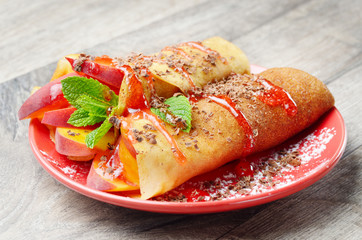 Crepe with peaches and chocolate