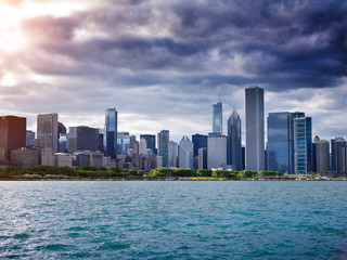 view of chicago skyline with cloudy sky and lens flare