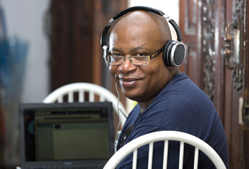 man with laptop and earphones
