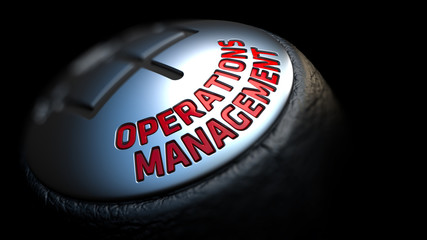 Operations Management on Gear Stick with Red Text.
