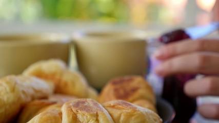 Hands Spreading Berry Jam croissant (Selective Focus, Focus on