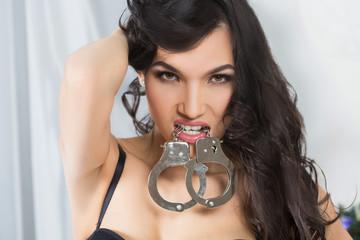 Woman in underwear, bite handcuffs, bdsm, sex toy