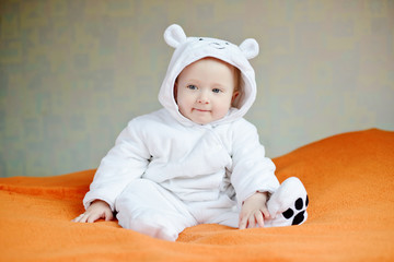 baby wearing costume of polar bear