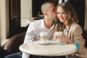 Happy couple drinking coffee in a local cafe.