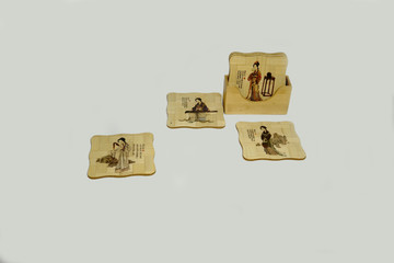 Supports for cups made of bamboo with a Japanese painting.