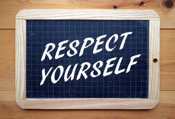 The phrase Respect Yourself in white text on a blackboard