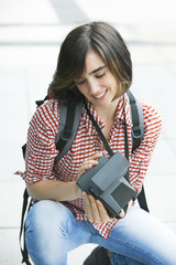 Young female photographer working