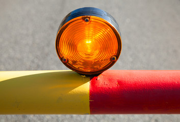 Red light on the automatic road barrier