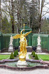 Sculpture of blowing gold angel, park of Linderhof Palace, Schlo