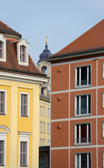 Narrow gap between bright buildings and Frauenkirche in it, Dres