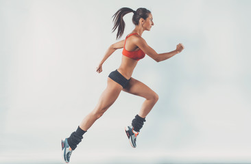 Active sporty young running woman runner athlete with copy space