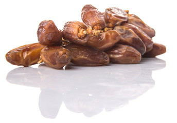 Date fruits over white background