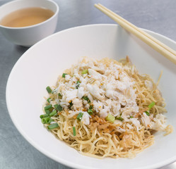 Noodle with crab in white bowl.