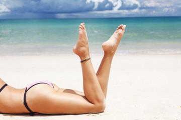 Beautiful legs on the beach