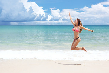 Girl jumping on a beach