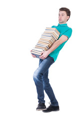 front view of going  handsome man carries a stack of books.