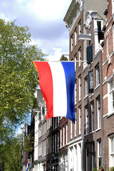 Flag of the Netherlands on the old house in Amsterdam