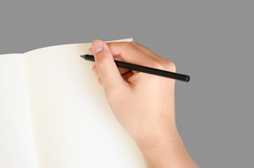 Hand write on notebook on gray background with clipping path