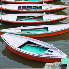 Pleasure boats on banks of the river Ganges at Varanasi