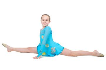 Cute little girl sits on a splits