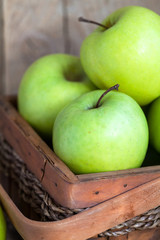 Ripe green apples (Golden Delicious) in a basket