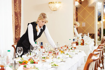 waitress at catering work in a restaurant