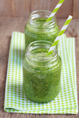 Healthy green smoothie made from spinach, kiwi, bananas