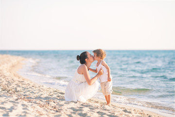 Mother and son kissing on the beach