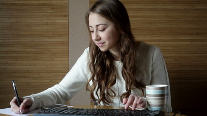 woman in the office at the computer typing on the keyboard