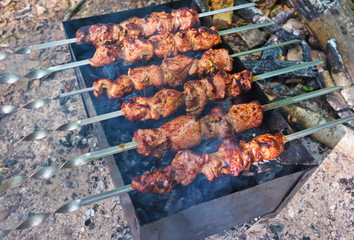 Grilling marinated meat on a grill