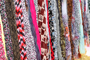 Variety of Hanging Scarves Providing Colourful Backdrop