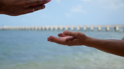 Husband Gives a Gift to His Wife against the Sea on Anniversary
