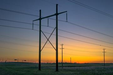 Power line in sunrise