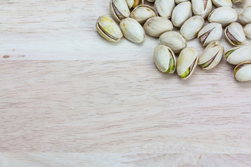 Close up pistachios on wooden background,Copy space