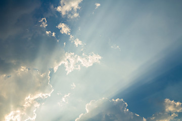 Clouds on blue sky background and sun ray